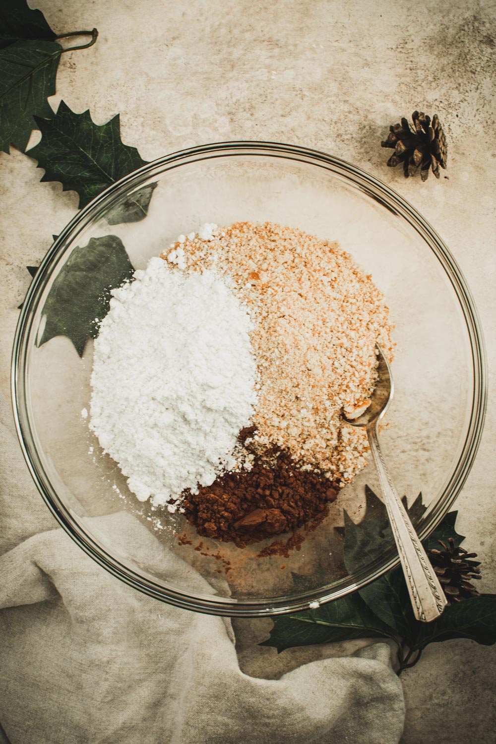 Old fashioned rum ball dry ingredients in glass mixing bowl.