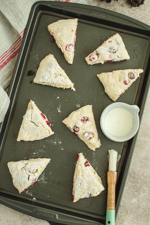 Cranberry orange scones dough on baking sheet.