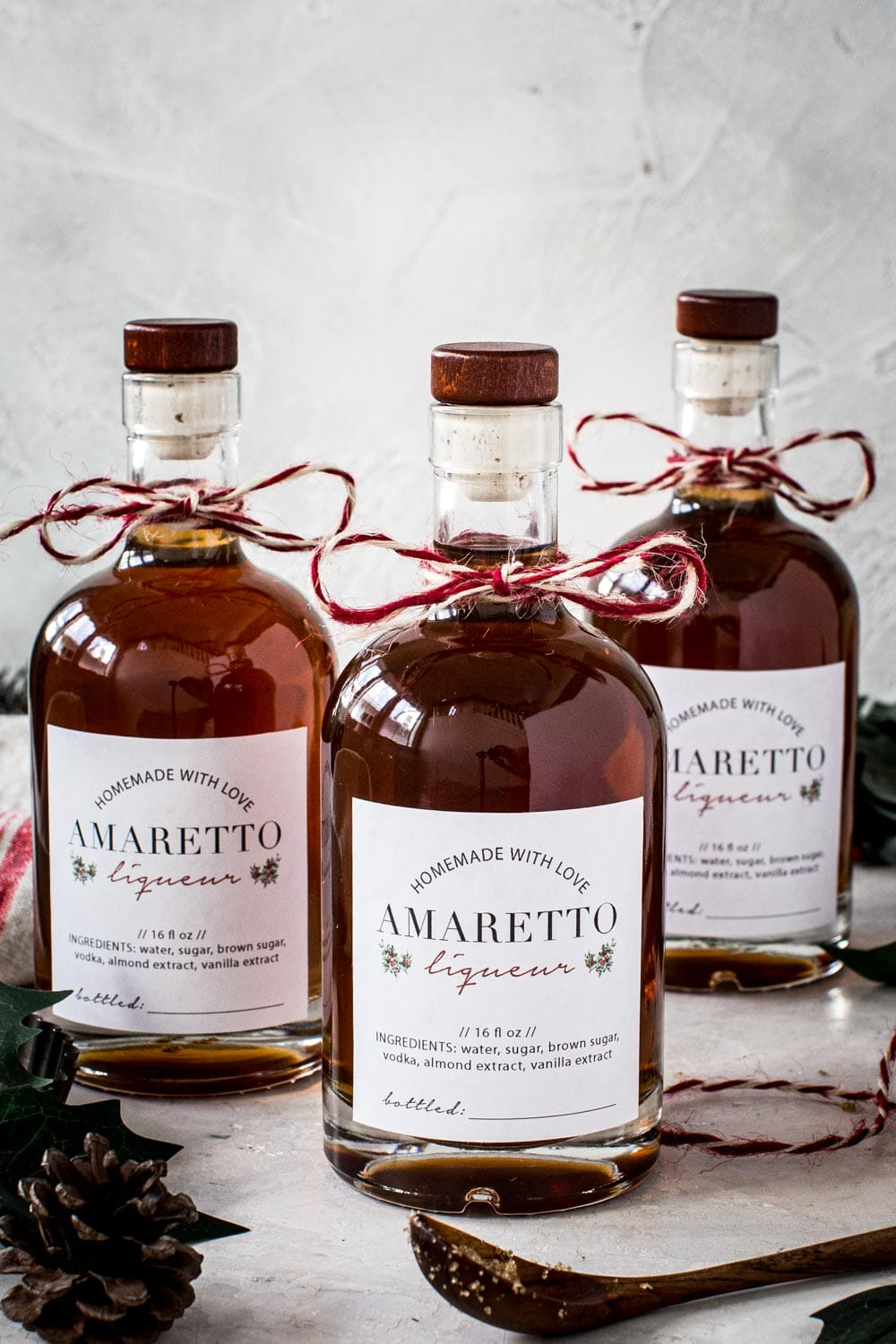 Homemade amaretto bottles with labels and string.