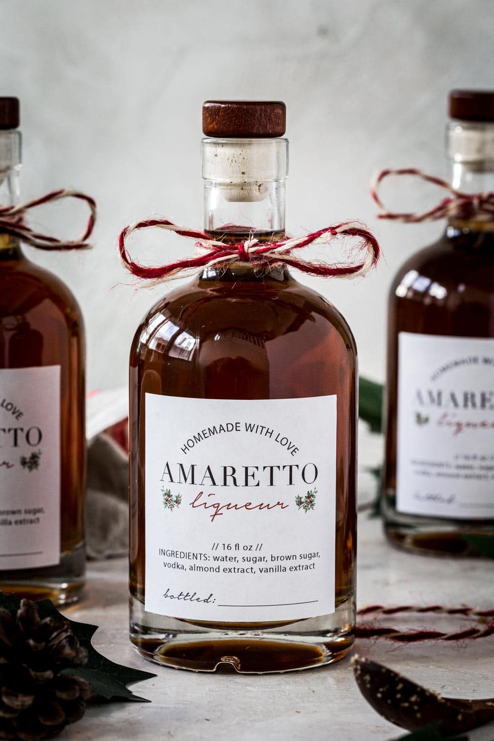 Homemade amaretto in glass bottles with homemade labels.