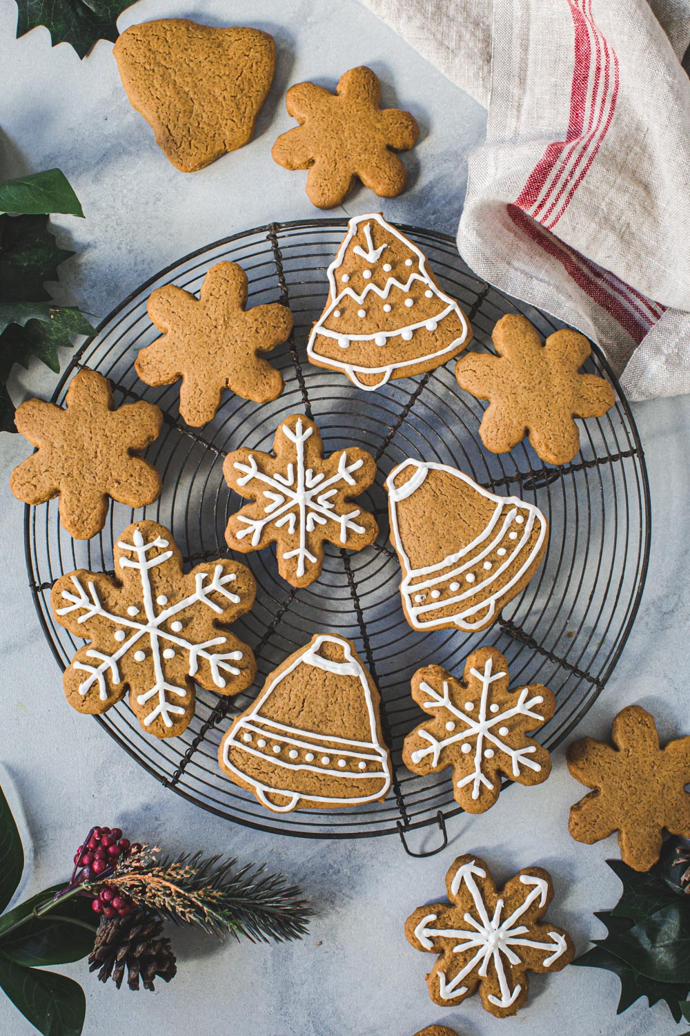 Iced gingerbread cutout cookies on a wire rack.
