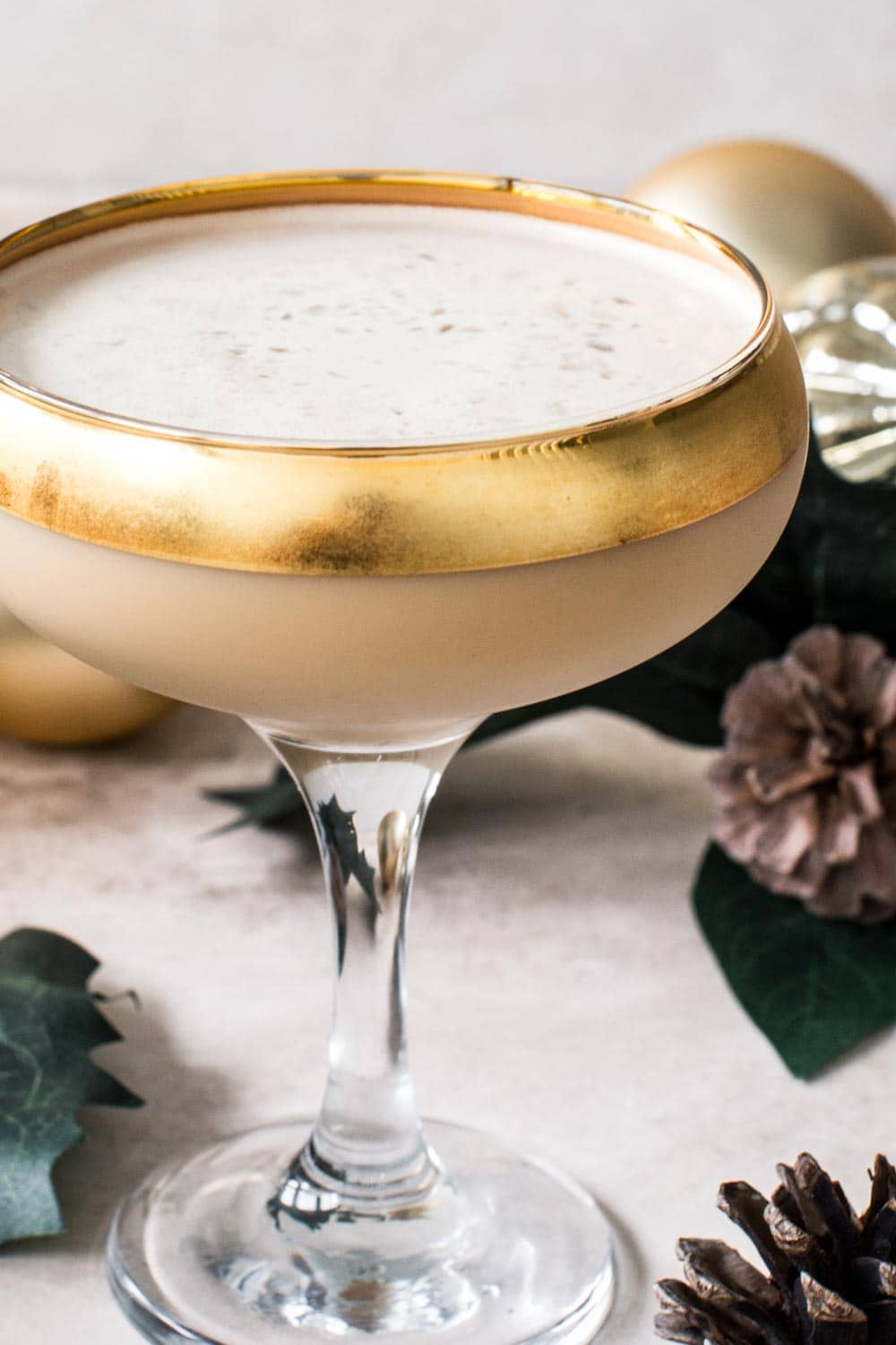 Toasted almond cocktail in a glass with a gold rim.