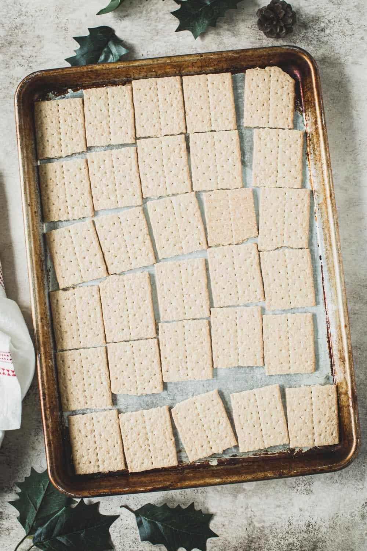 Graham crackers on a rimmed baking sheet.