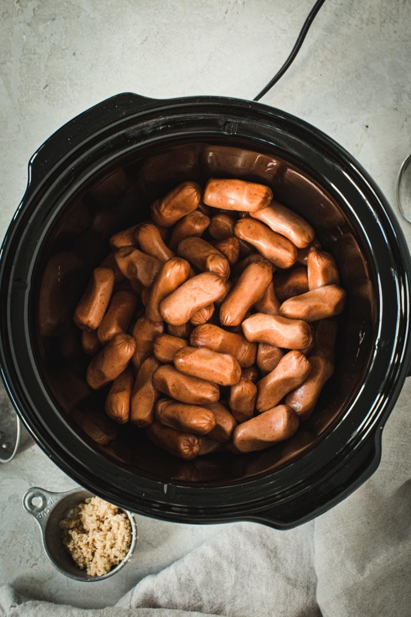 Little Smokies in a black crockpot.