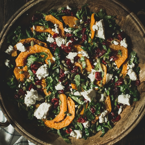 Butternut squash salad in a wooden bowl.