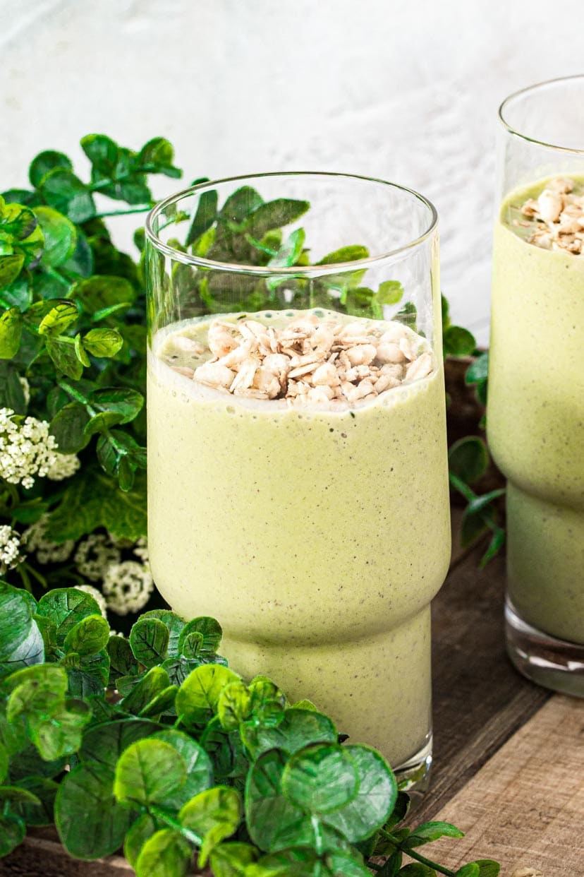 Simple green smoothie in a glass topped with granola.