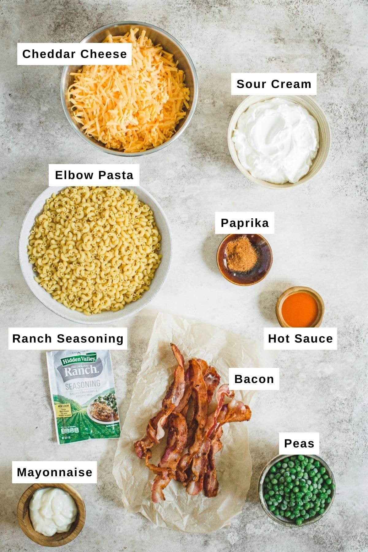 Bacon ranch pasta salad ingredients in bowls.