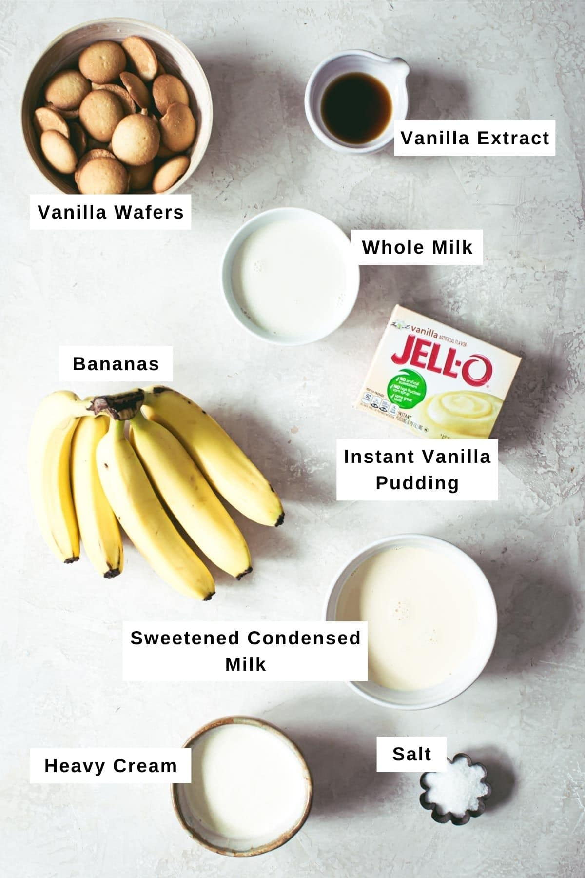 Banana pudding trifle ingredients in different sized bowls.