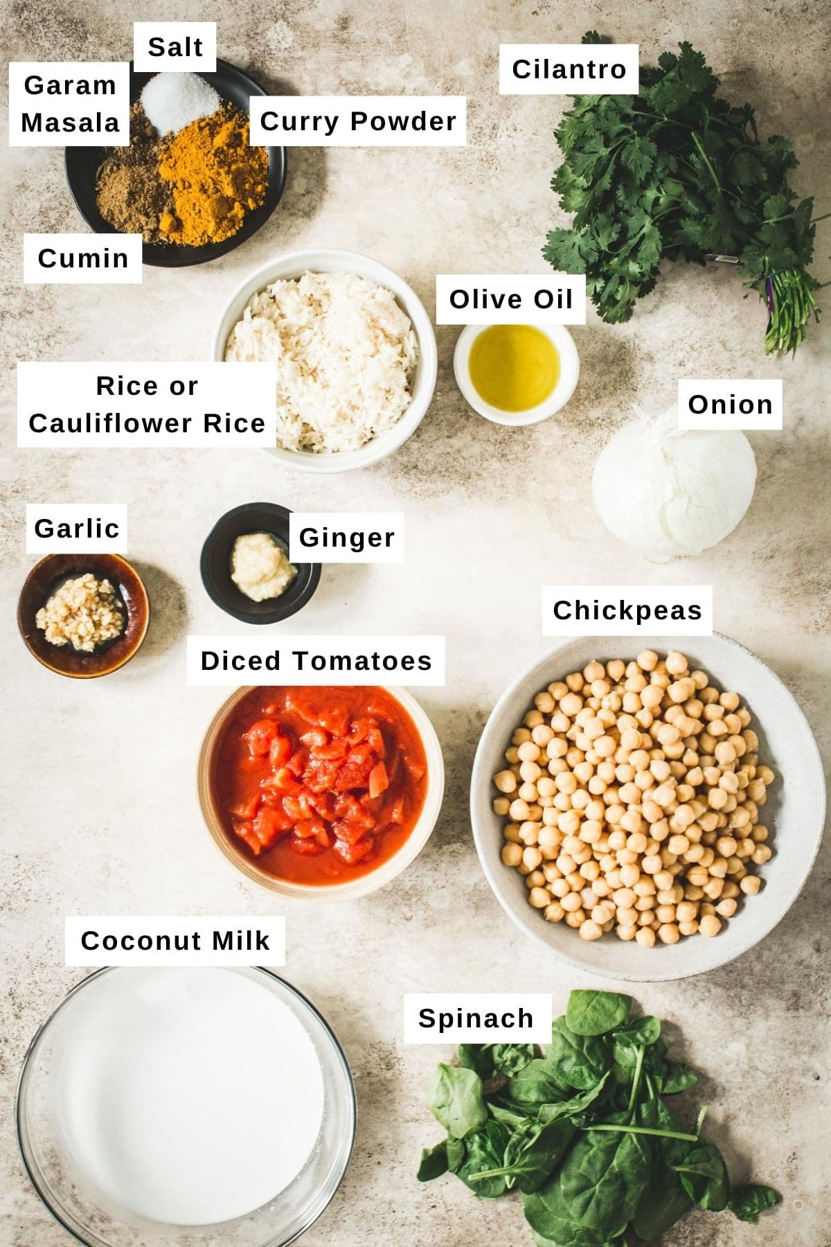 Chickpea spinach curry ingredients in different bowls.
