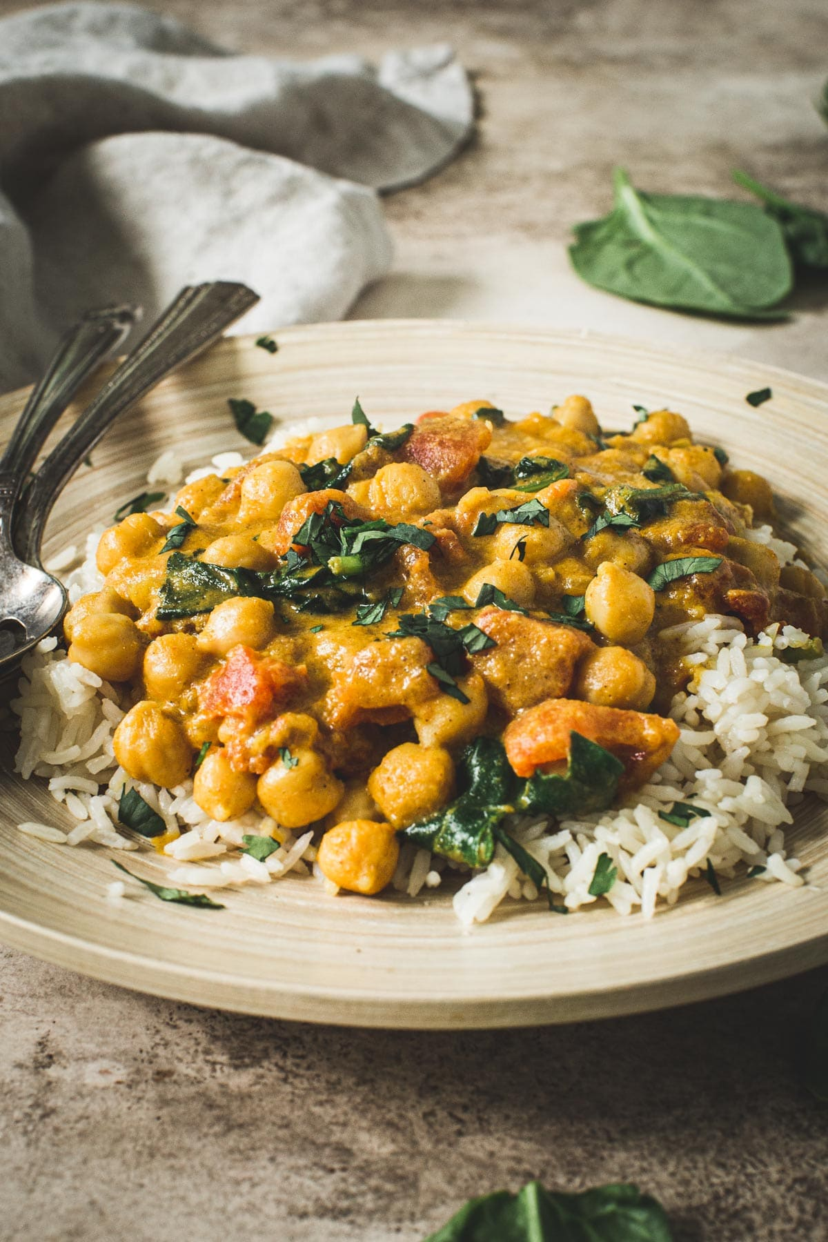 Chickpea spinach curry topped with cilantro and served over rice.