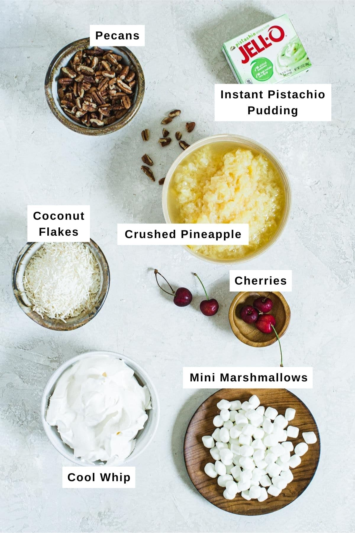 Pistachio pudding salad ingredients in different bowls.