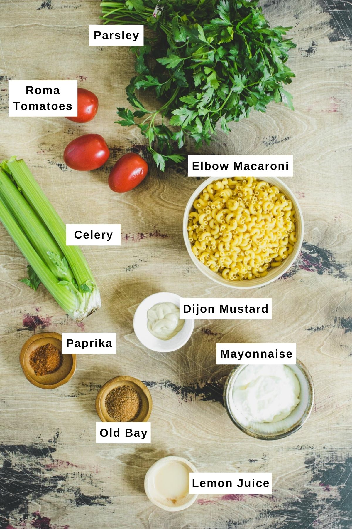 Southern macaroni salad ingredients laid out on table.