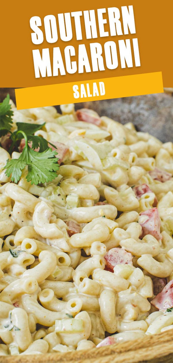 Close up of Southern macaroni salad topped with fresh parsley.