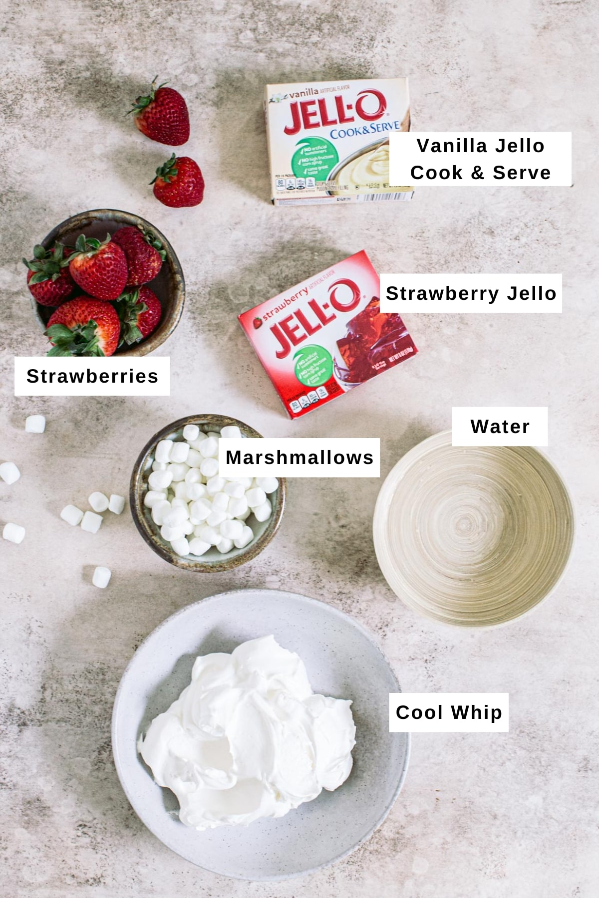 Ingredients for making strawberry Jello fluff salad in different bowls.