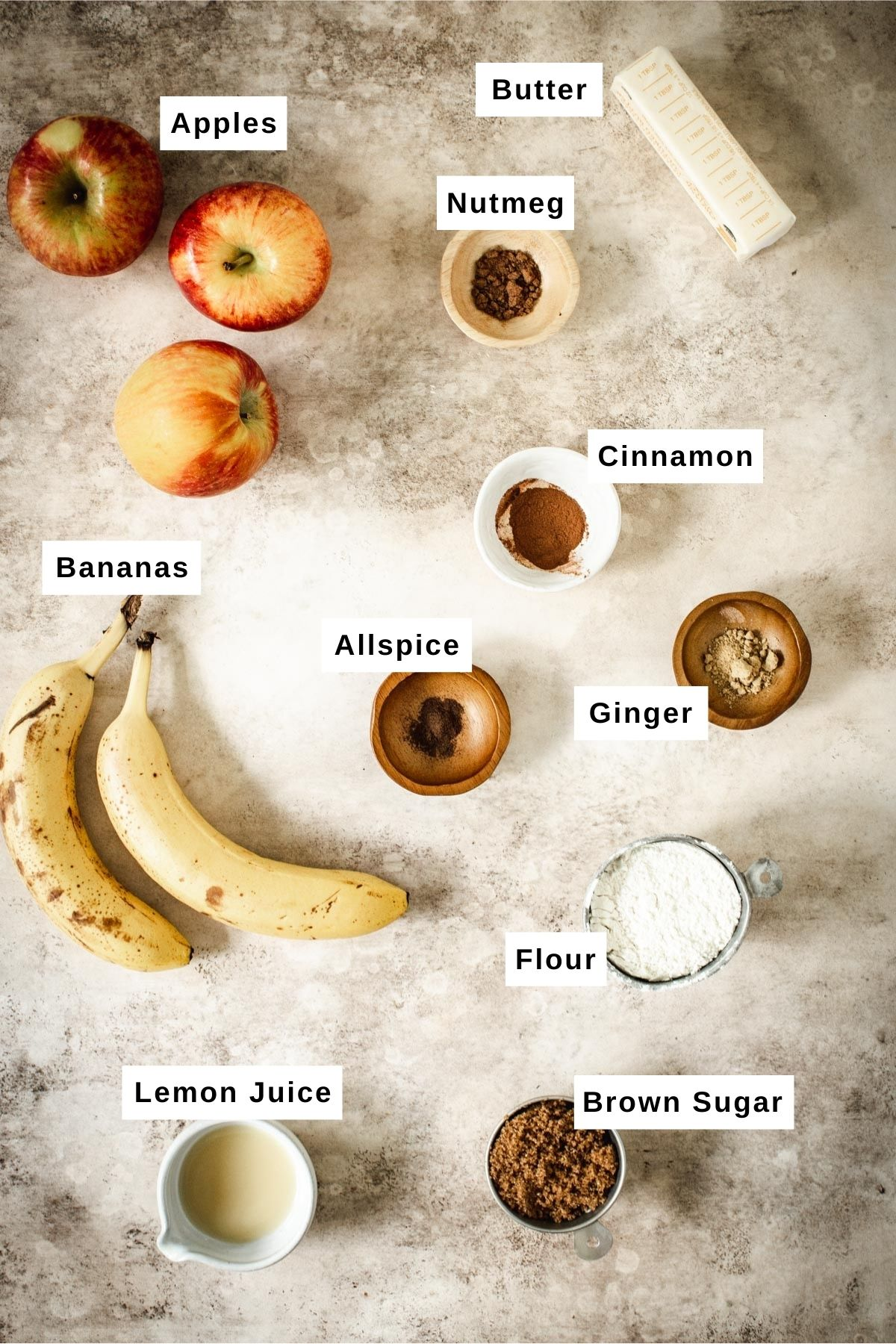 Baked apple crumble ingredients in bowls.