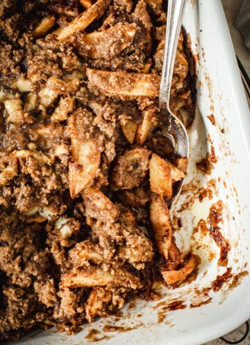 Baked apple crumble without oats in a baking dish.