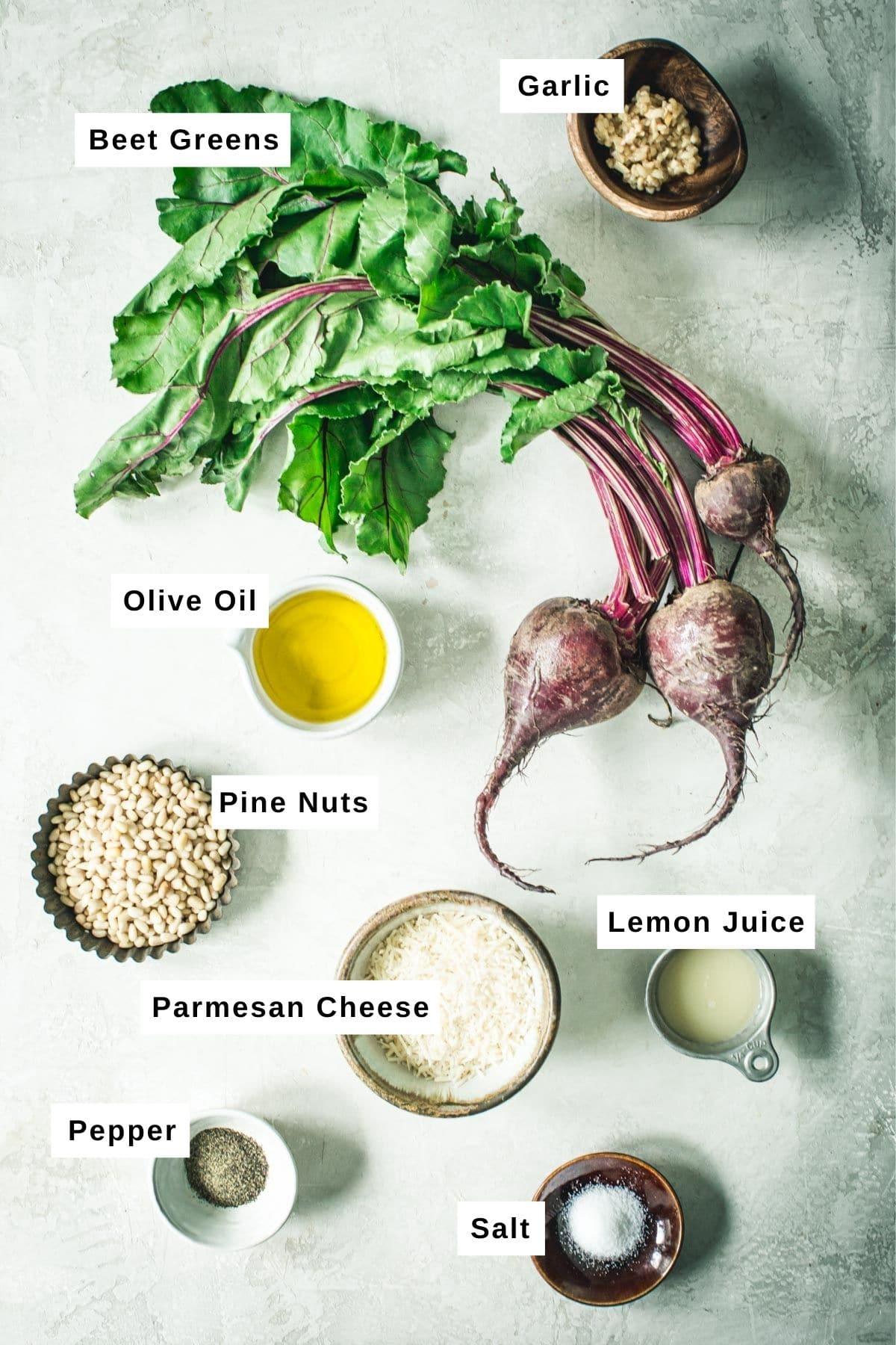 Beet greens pesto ingredients in bowls.