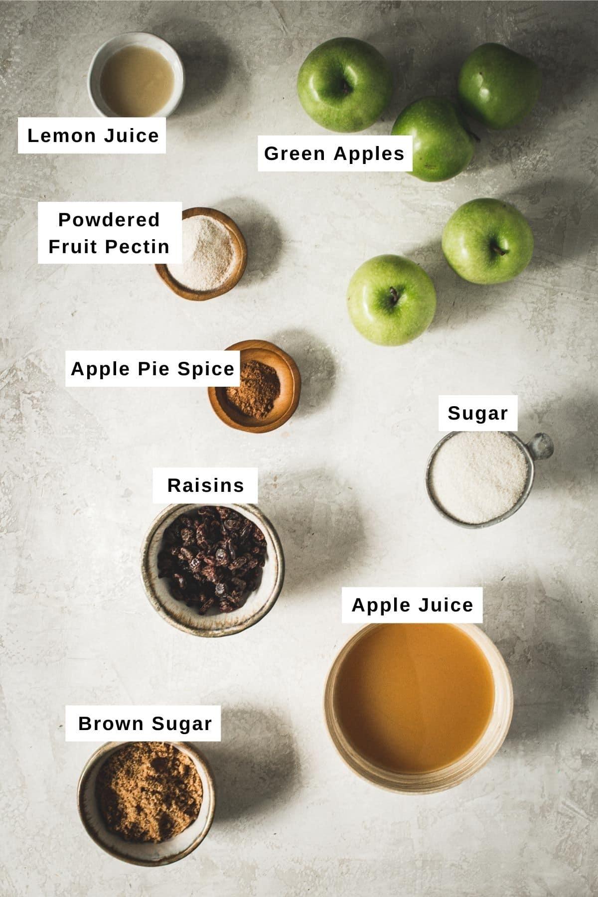 Apple jam ingredients in bowls.