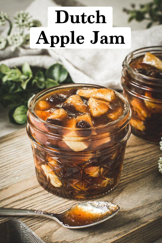 Dutch apple jam in a quarter-pint jar on a wooden cutting board.
