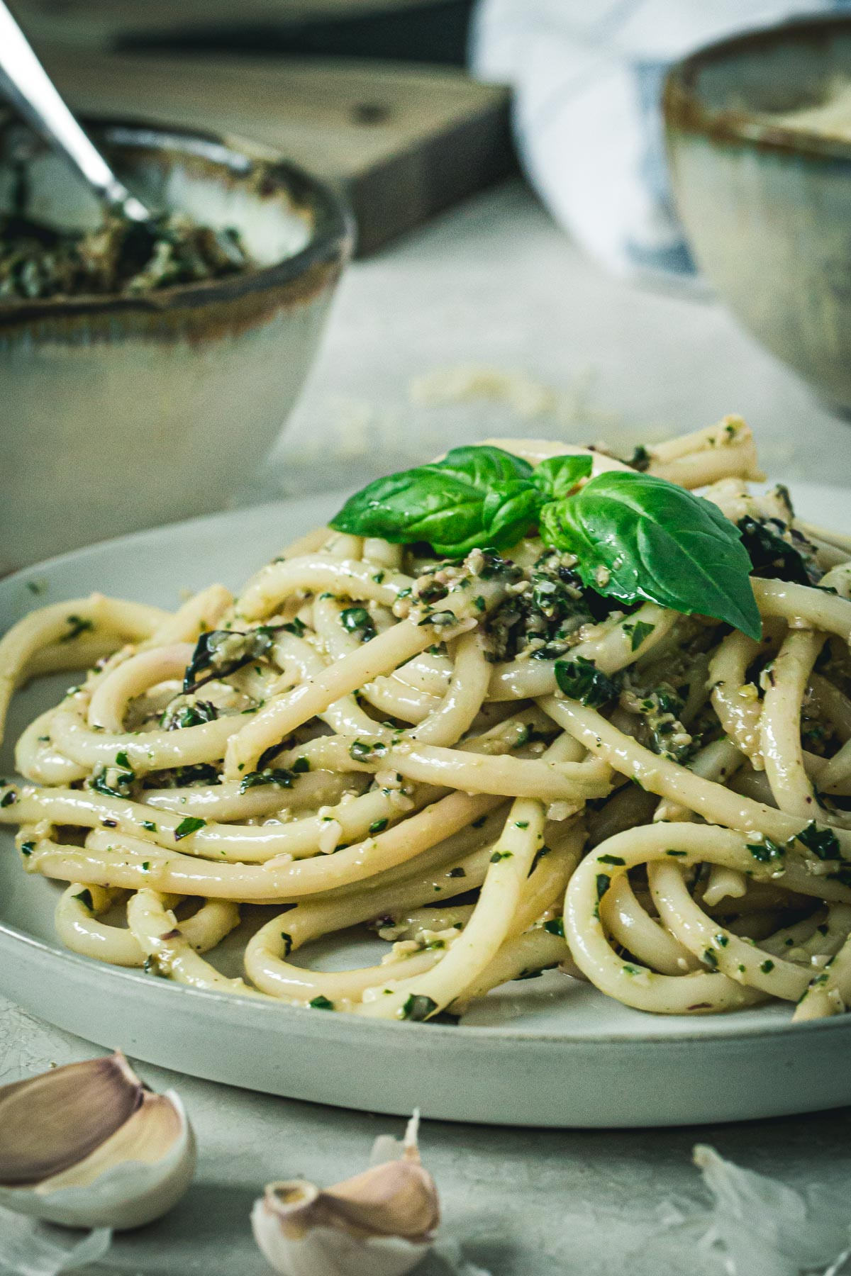 Beet greens pesto pasta on a white plate.