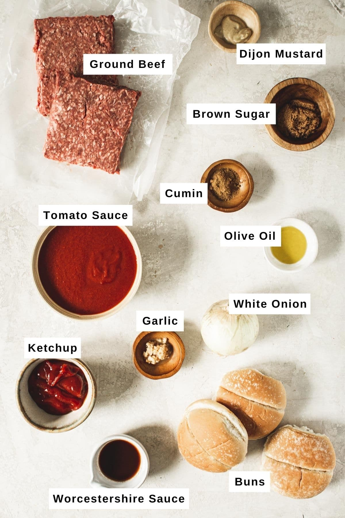 Slow cooker sloppy joes ingredients in different bowls.