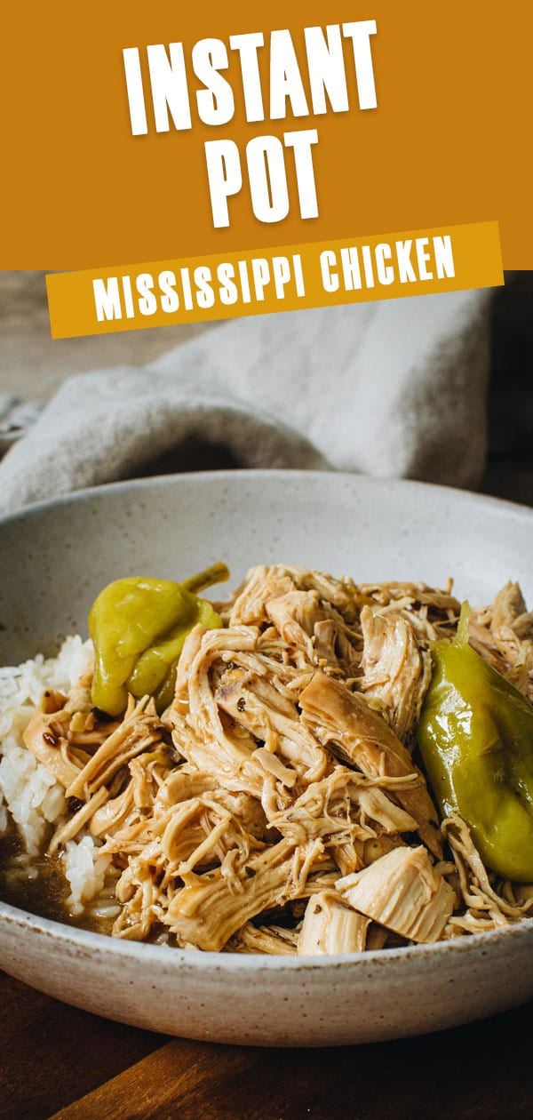 Mississippi chicken over rice in a white bowl.
