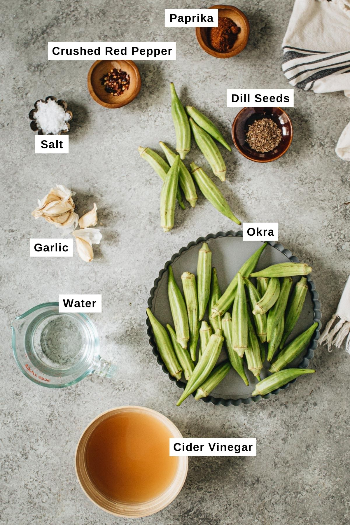 Pickled okra ingredients in different bowls.