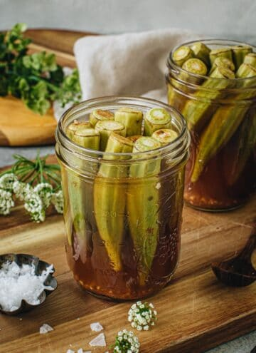 Quick pickled okra in a glass jar.