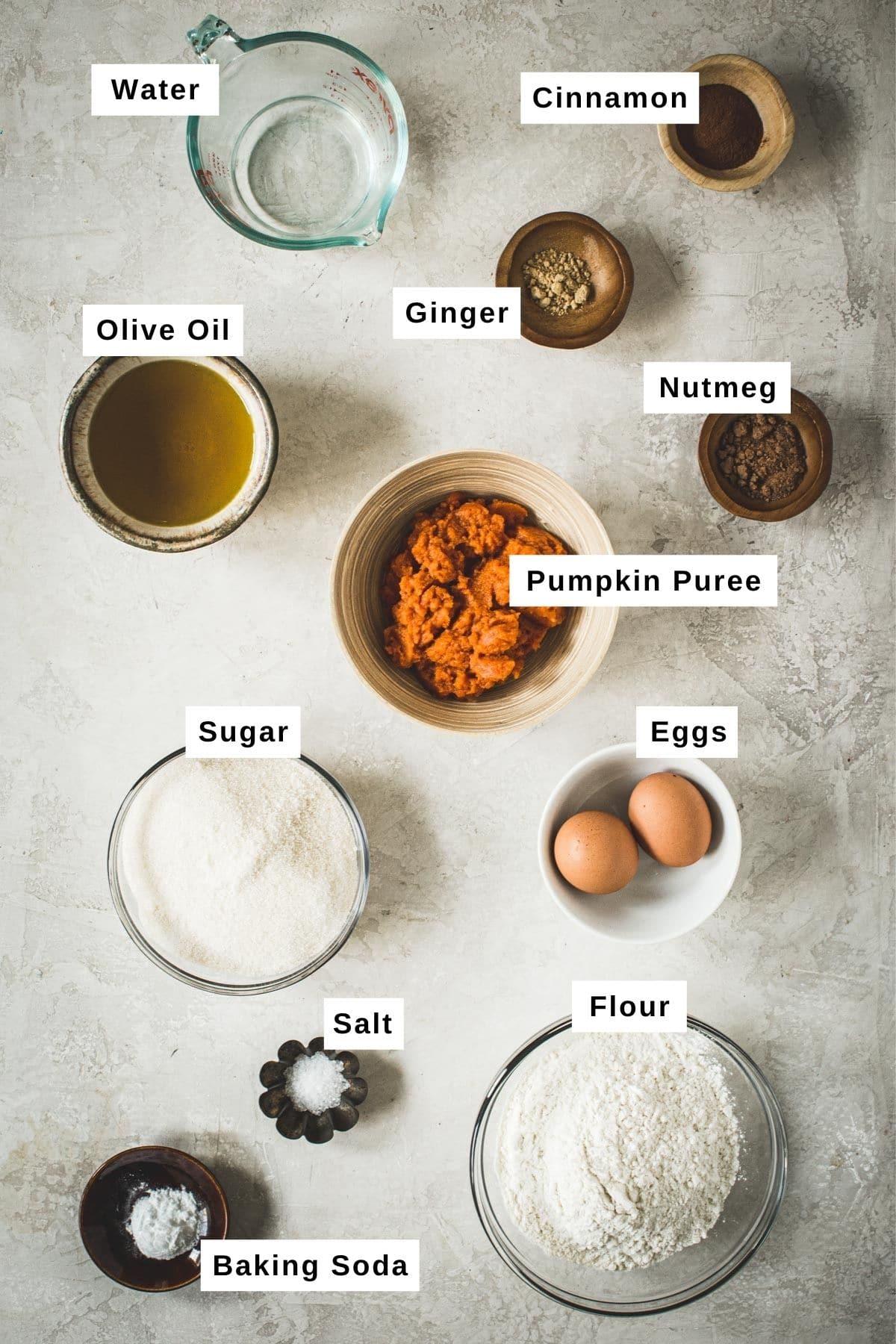 Pumpkin bread ingredients in various bowls.