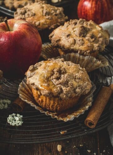 Apple crumble muffins on a wire rack.