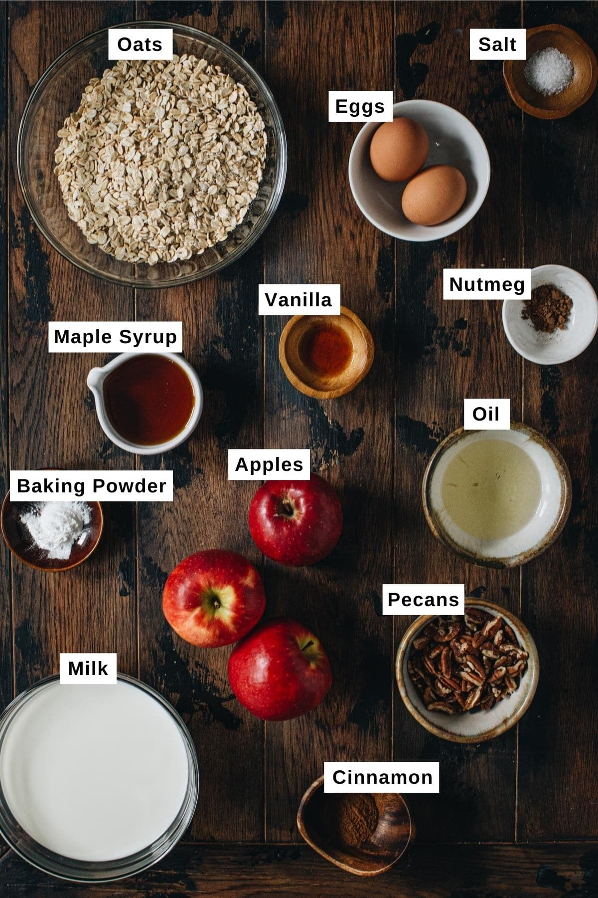 Baked apple oatmeal ingredients on a wooden table.