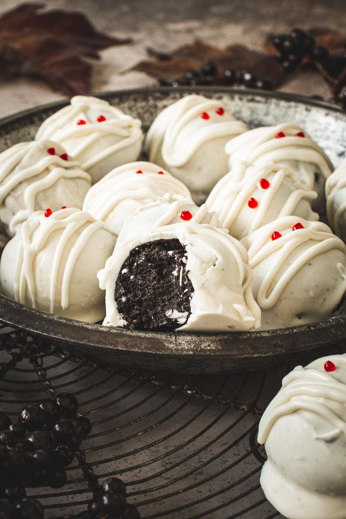 Oreo cookie ball with a bite taken out of it sitting on top of other balls.