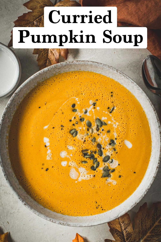 Curried pumpkin soup with pumpkin seeds on top.