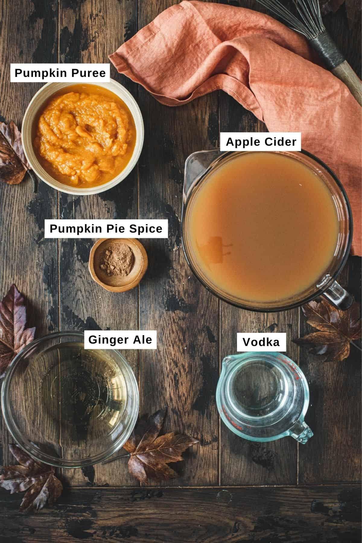 Halloween pumpkin punch ingredients in bowls.
