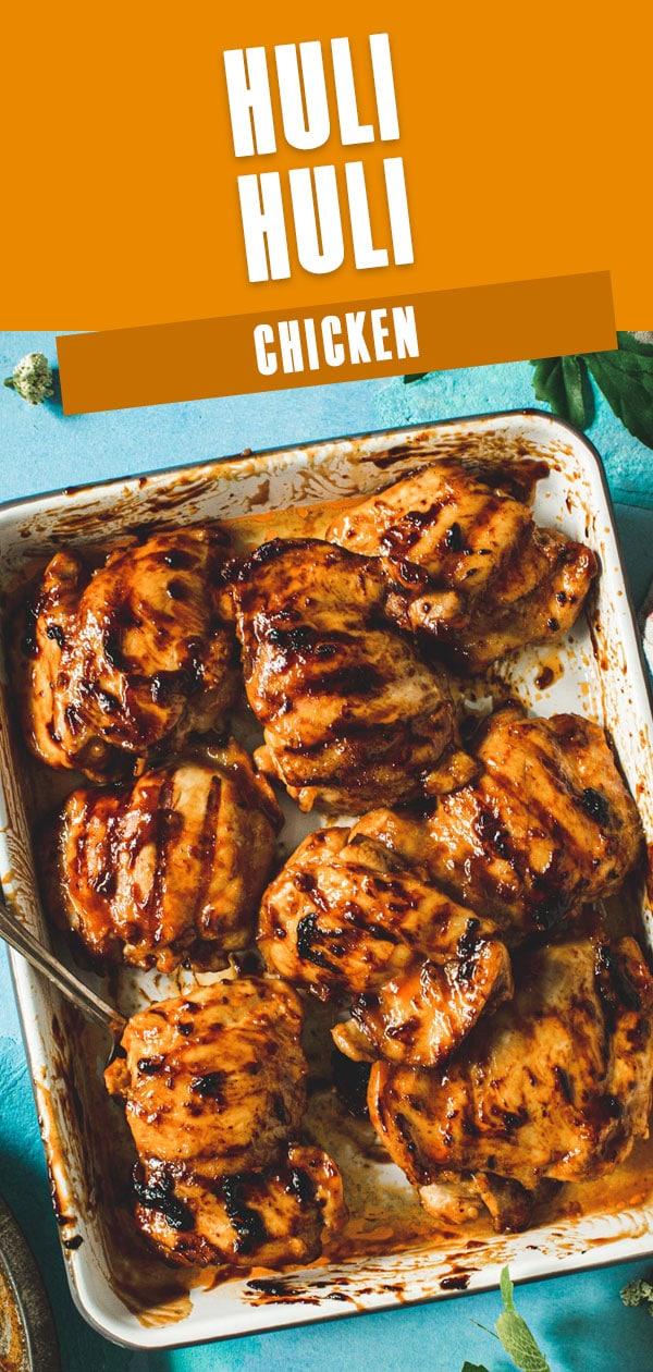 Huli huli chicken in a rimmed baking sheet.
