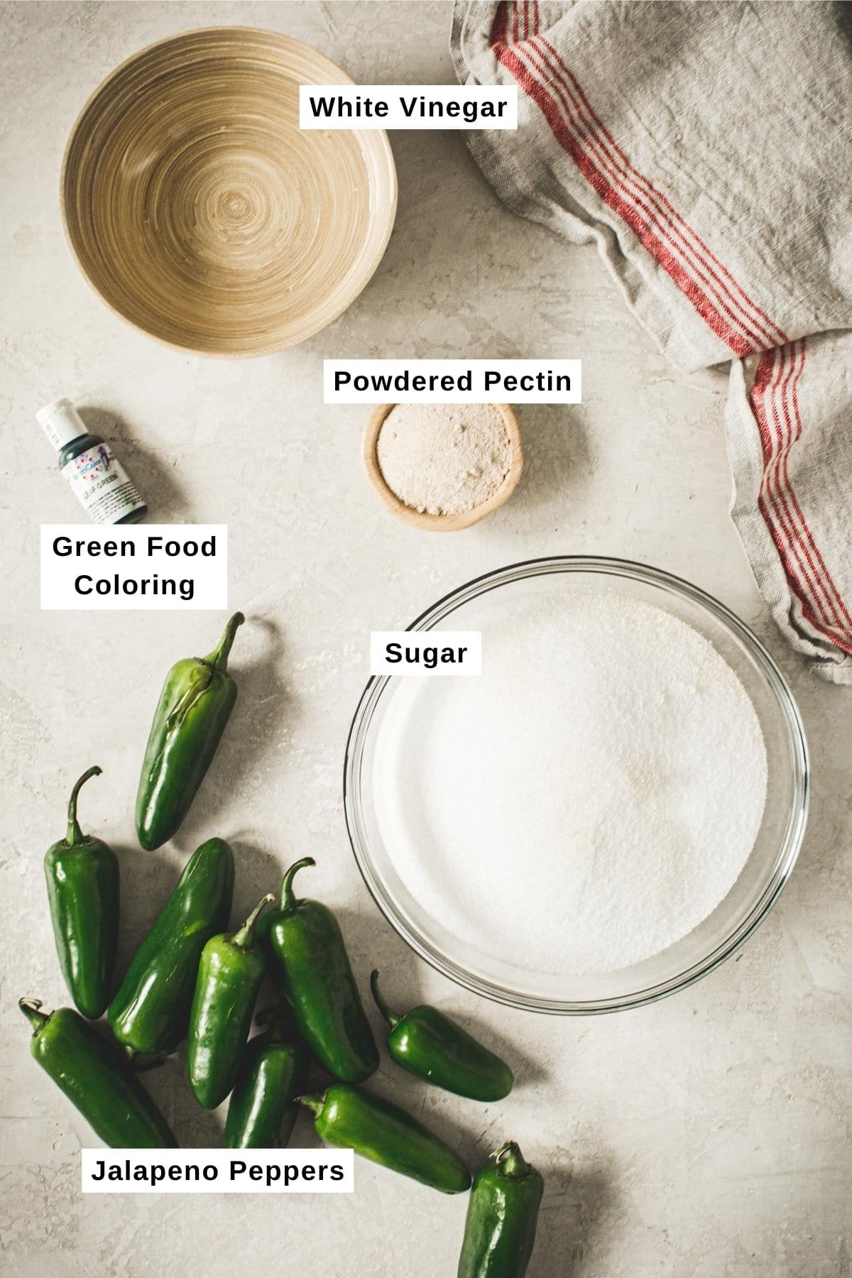 Jalapeno pepper jelly ingredients on a white table.
