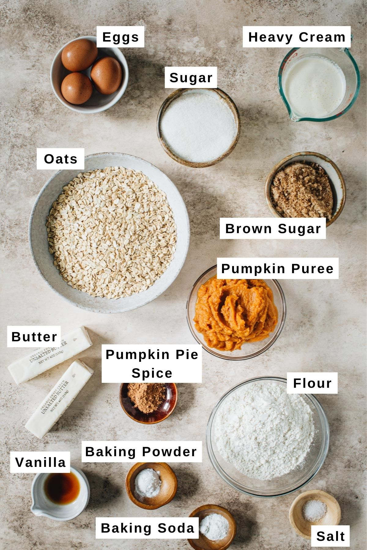 Pumpkin crisp ingredients in various sized bowls.