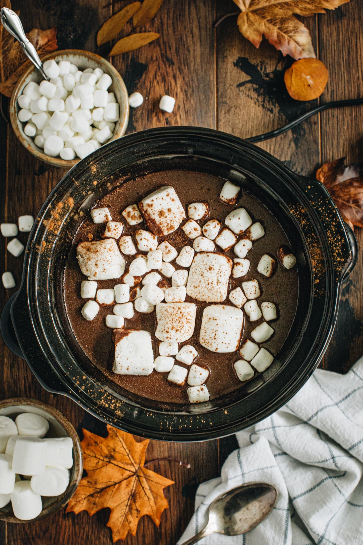 Pumpkin hot chocolate in the slow cooker topped with marshmallows.