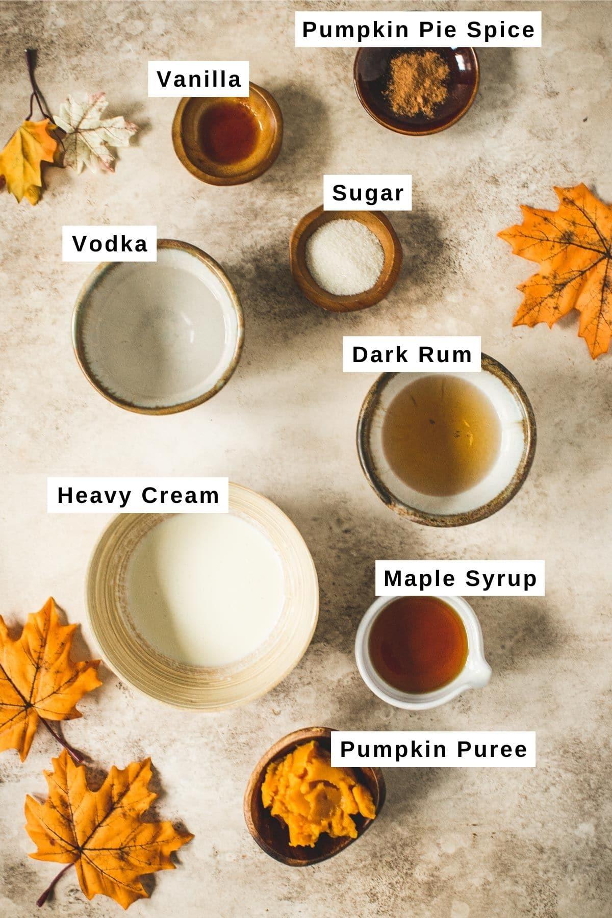 Pumpkin martini ingredients in various bowls.