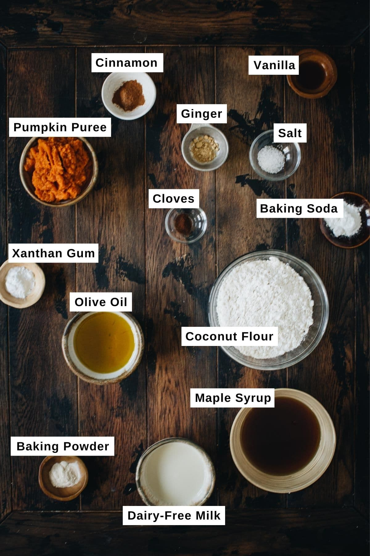 Vegan pumpkin muffin ingredients in various bowls.