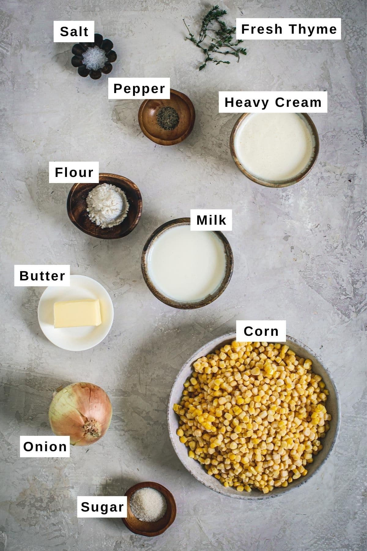 Creamed corn ingredients in different sized bowls.