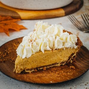 No-bake pumpkin pie slice topped with whipped cream and cinnamon.