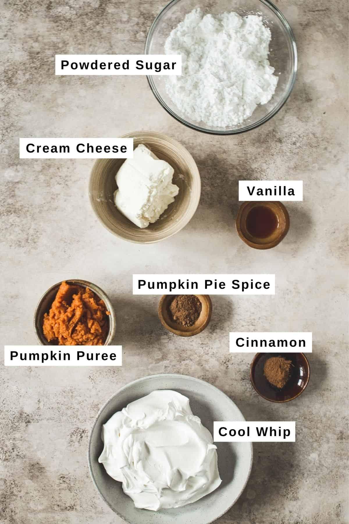Pumpkin pie cheesecake dip ingredients in different bowls.