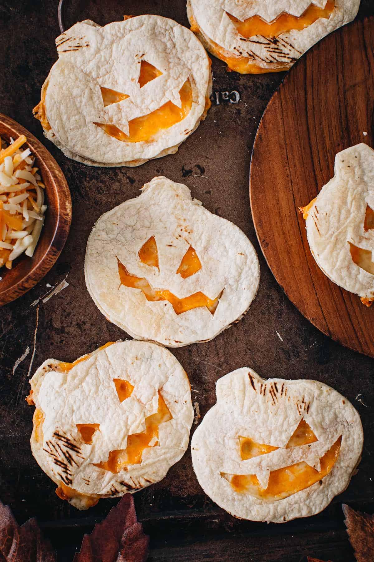 Pumpkin oven quesadillas on a baking sheet.